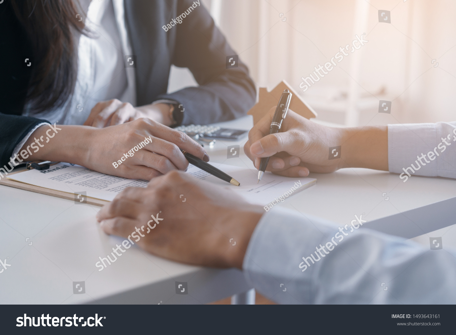 Salesmen are letting the male customers sign the sales contract, Asian women and men are doing business in the office, Business concept and contract signing