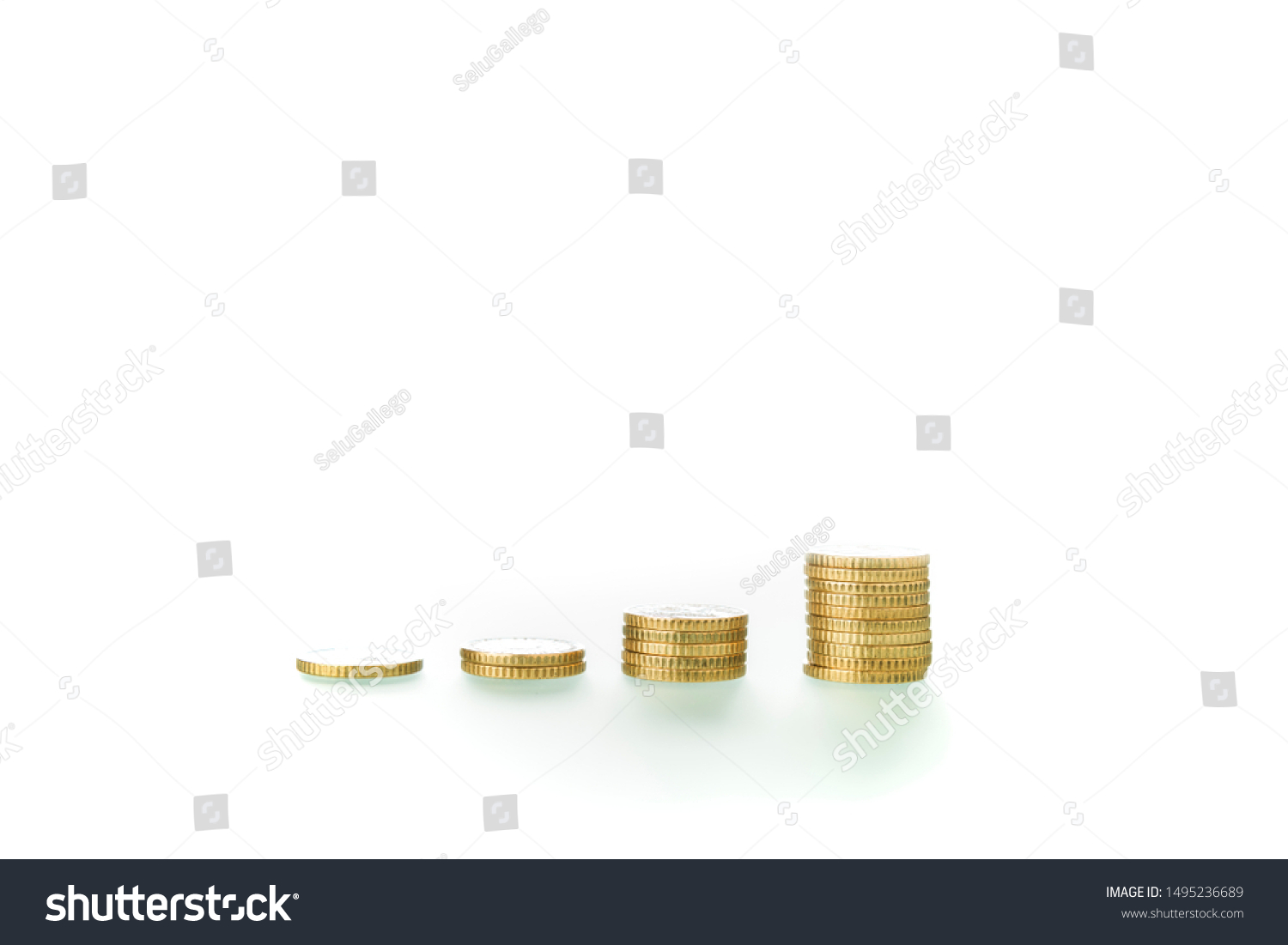 Coins grouped in uneven piles on white background, showing the concept of economic ascent and rising economy.