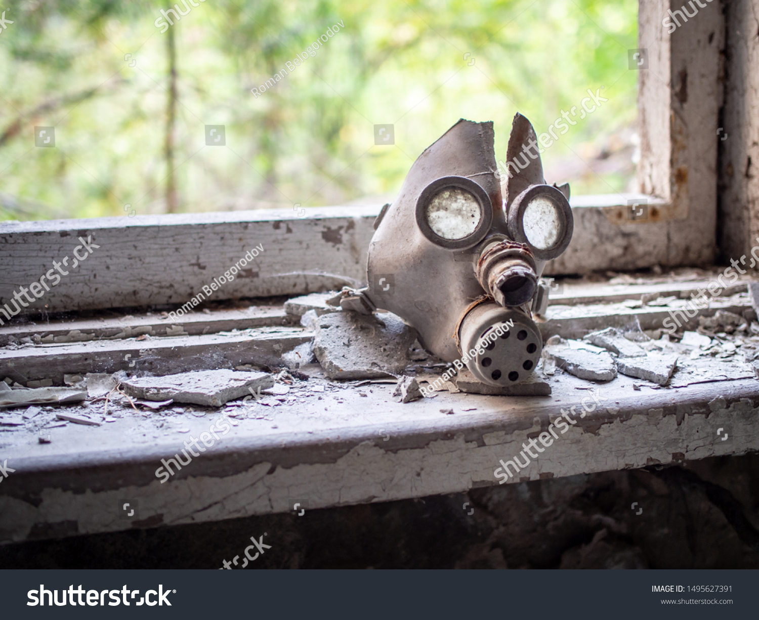 Old children's gas mask inside of the abandoned Pripyat Elementary School No. 3 in Pripyat city, Chernobyl Exclusion Zone, Ukraine #1495627391