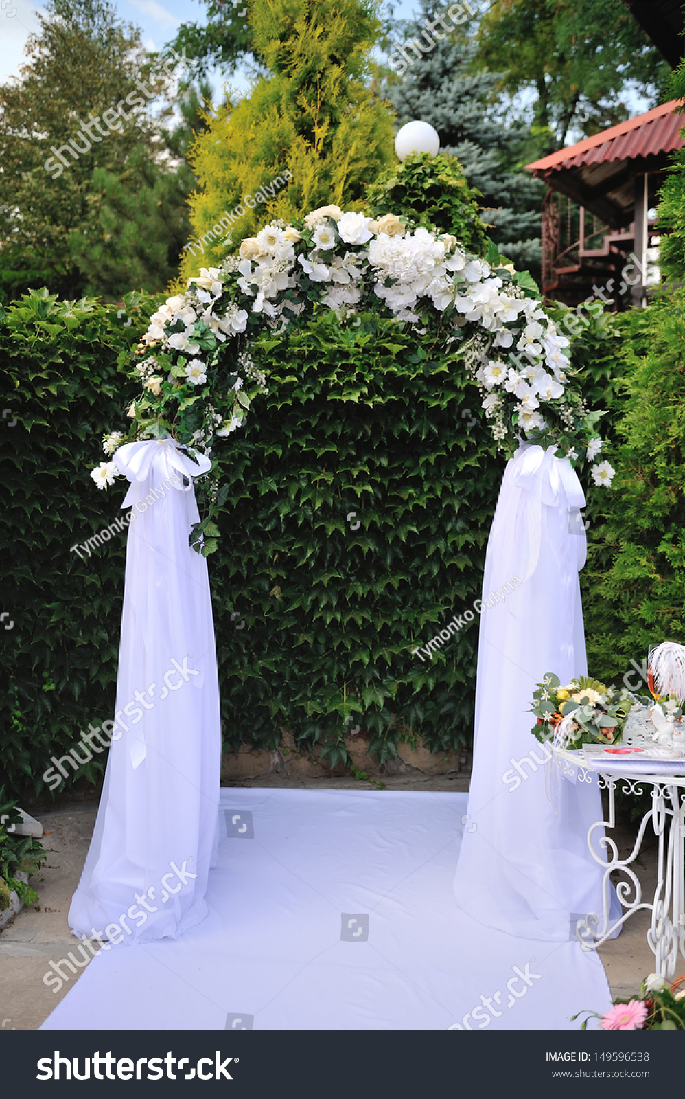 stock photo wedding arch with white flowers 149596538 - blue and white beach wedding