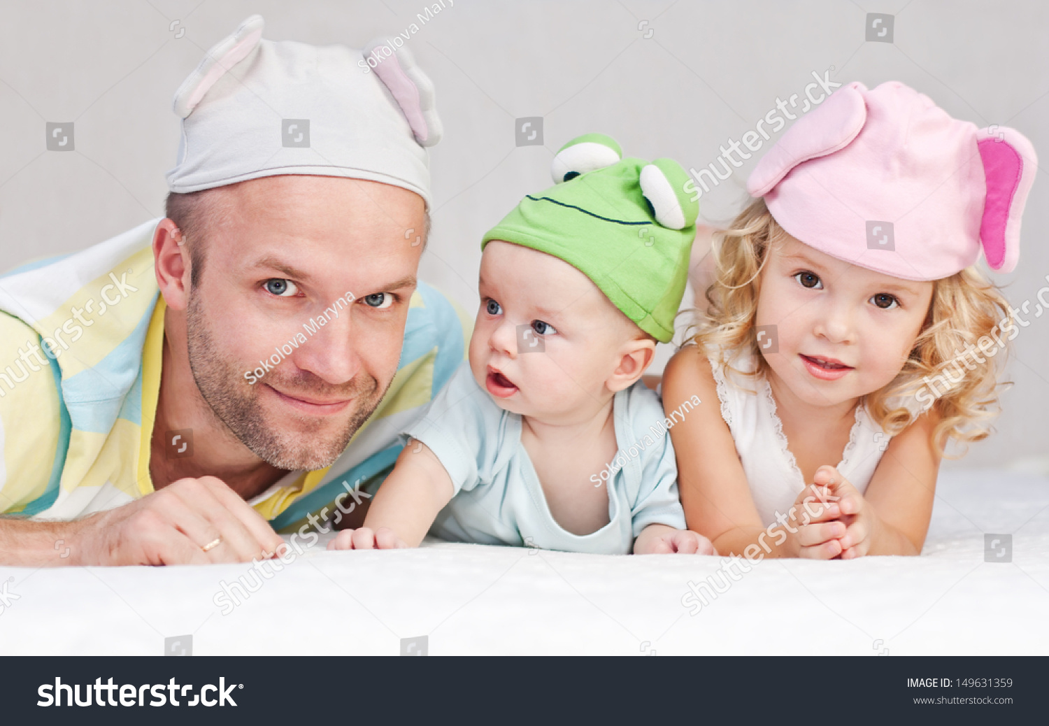 Happy Dad Kids Funny Hats Lying Stock Photo Edit Now 149631359