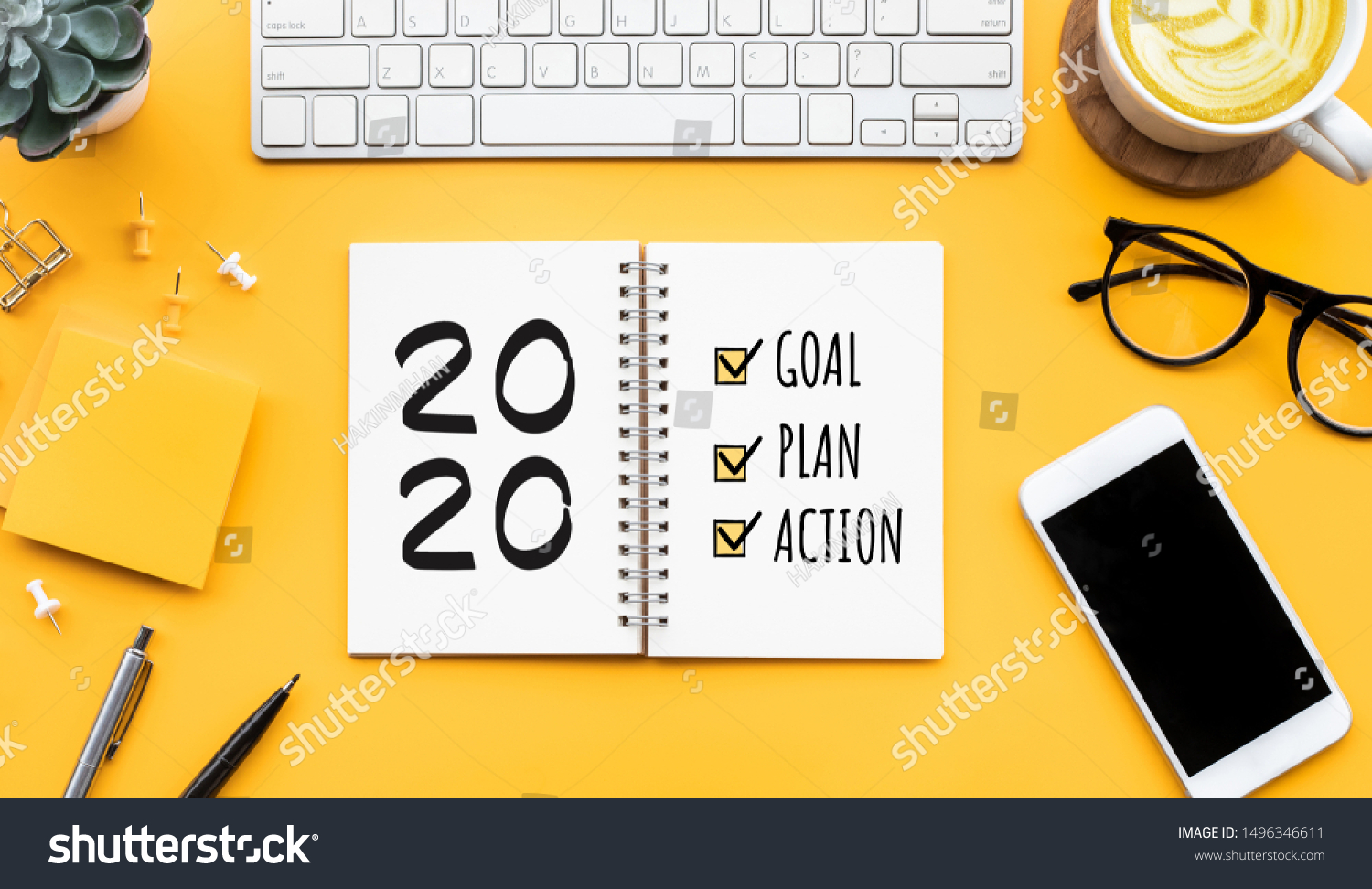 2020 new year goal,plan,action text on notepad with office accessories.Business motivation,inspiration concepts ideas #1496346611
