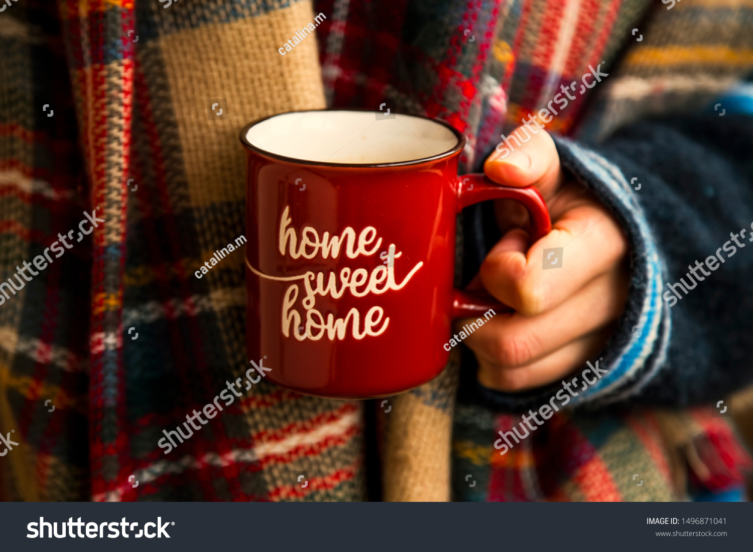 Cozy fall coffee cup, woman hands holding warm rustic autumn coffee cup with cozy scarf, cozy fall still life #1496871041