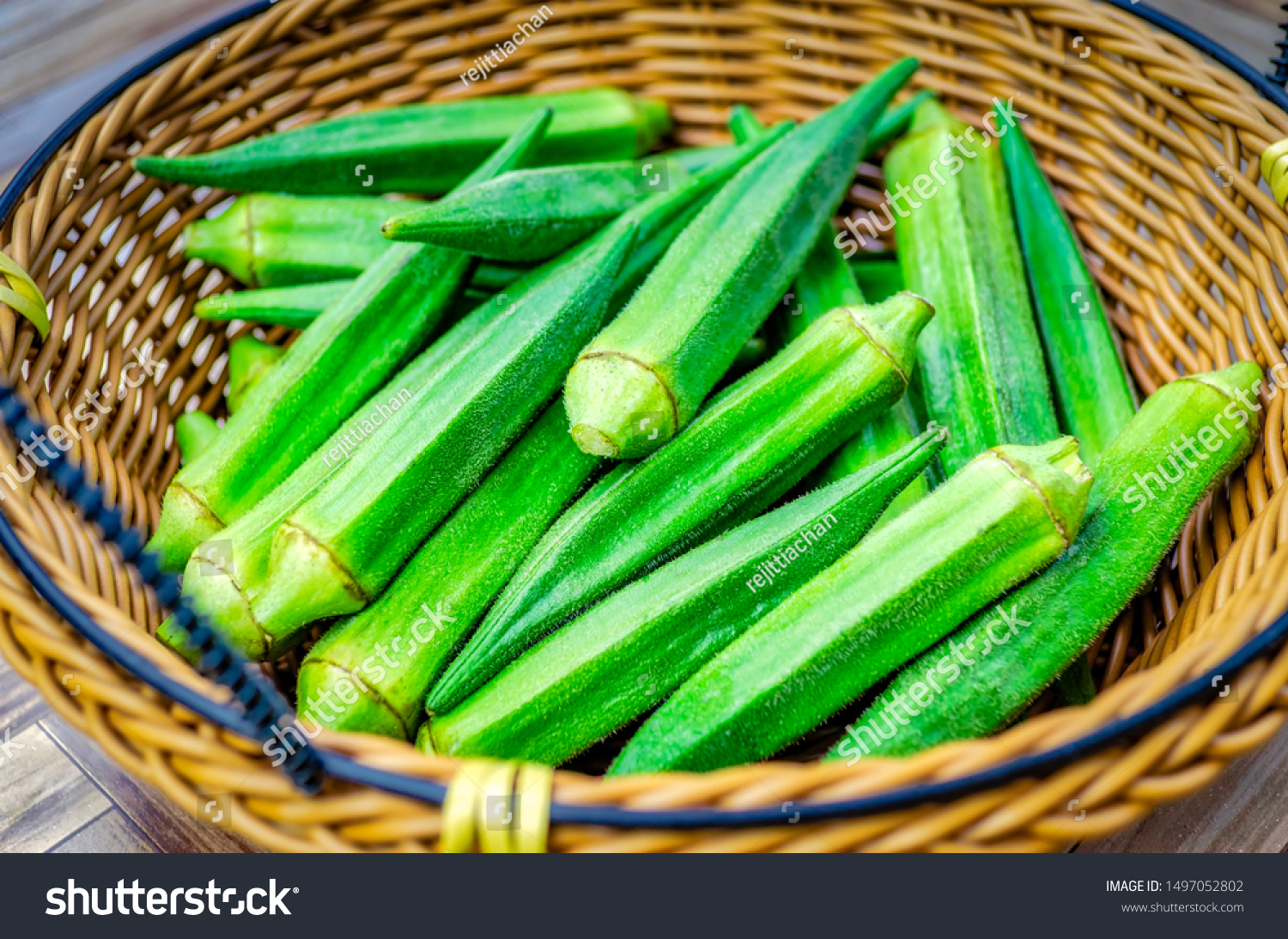 Closeup of fresh raw Okra vegetables in a basket.