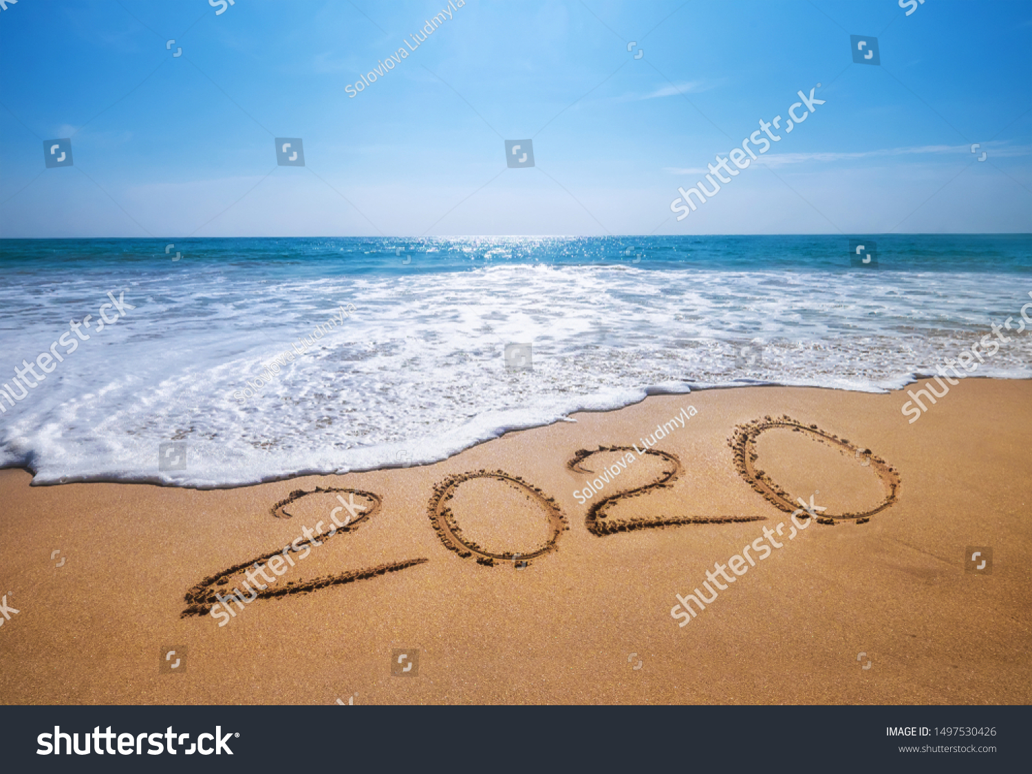 Happy New Year 2020 is coming concept sandy tropical ocean beach lettering. Exotic New Year celebration concept image. #1497530426