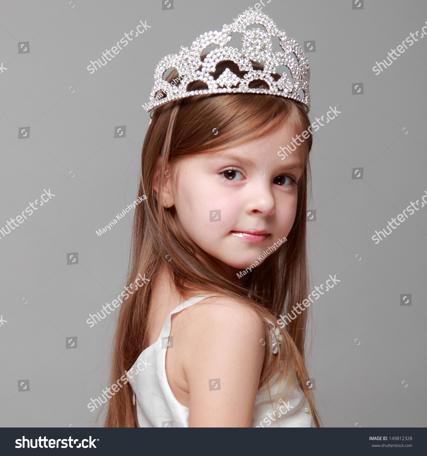 young girl wearing crown white dress stock photo (edit now
