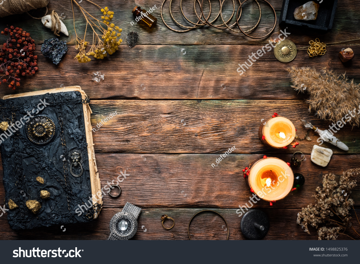 Magic recipe book and a magic potions on a table. Witchcraft background with copy space. Druid or witch doctor table. #1498825376