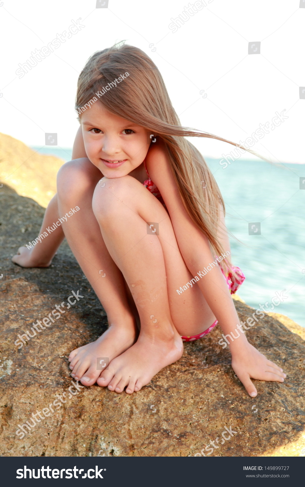 Need ROME girl sitting on rock