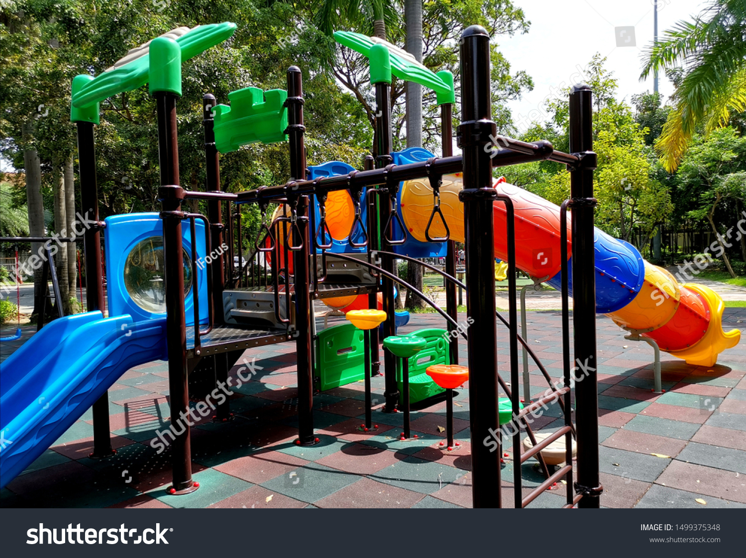 Colorful outdoor playground with tunnel slide and tower