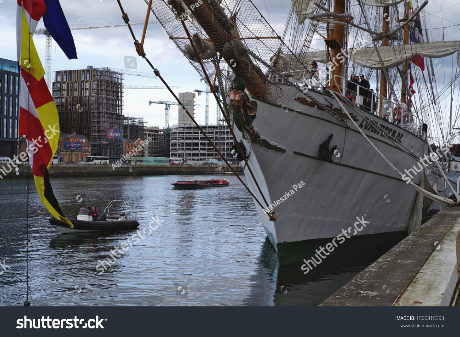 DUBLIN, IRELAND - SEPTEMBER 7, 2019: Mexican Navy training ship Cuauhtemoc docked in Dublin, on the River Liffey. Bow view, with signal flags in the front.