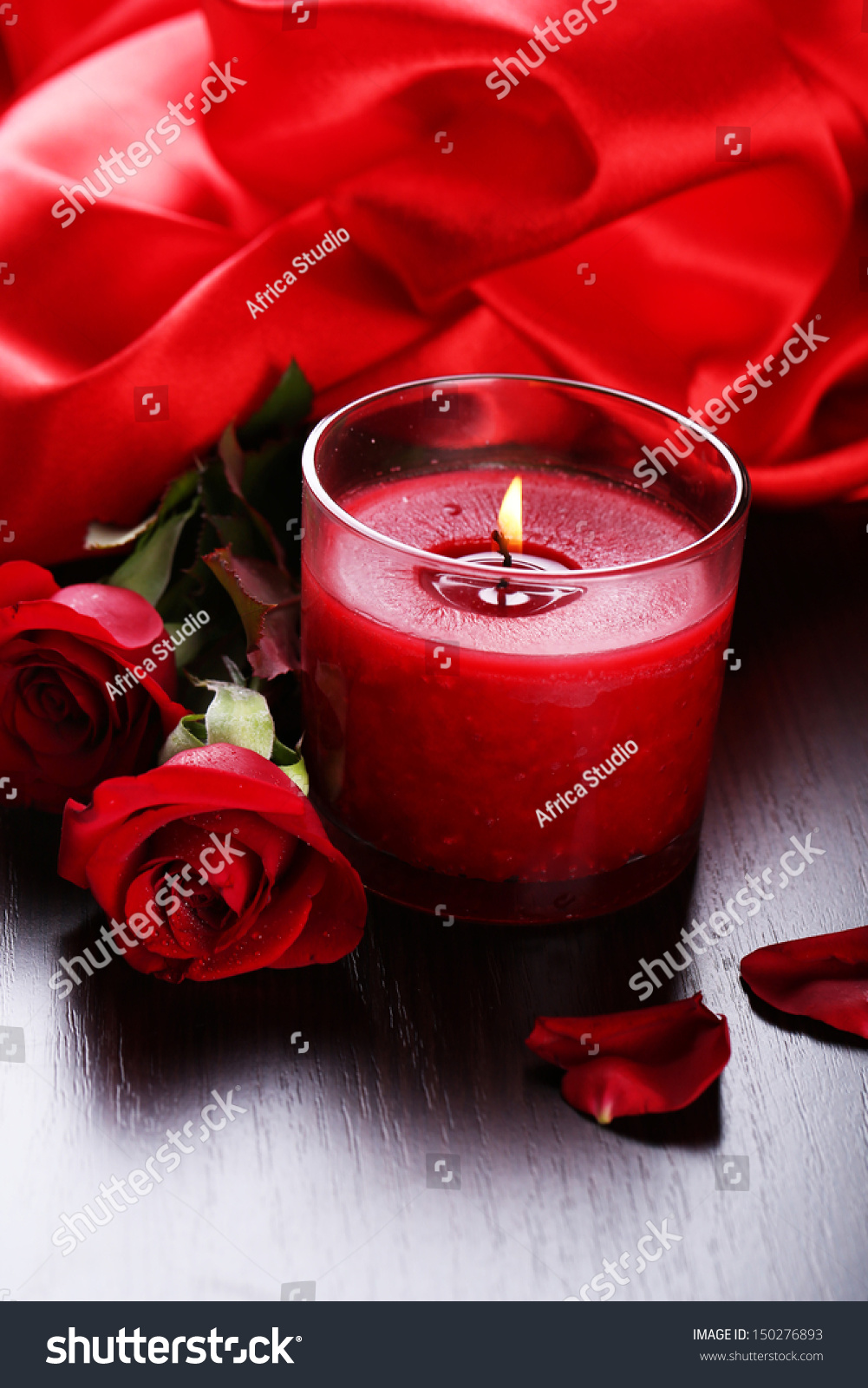Beautiful romantic red candle with flowers close up ez canvas izmirmasajfo
