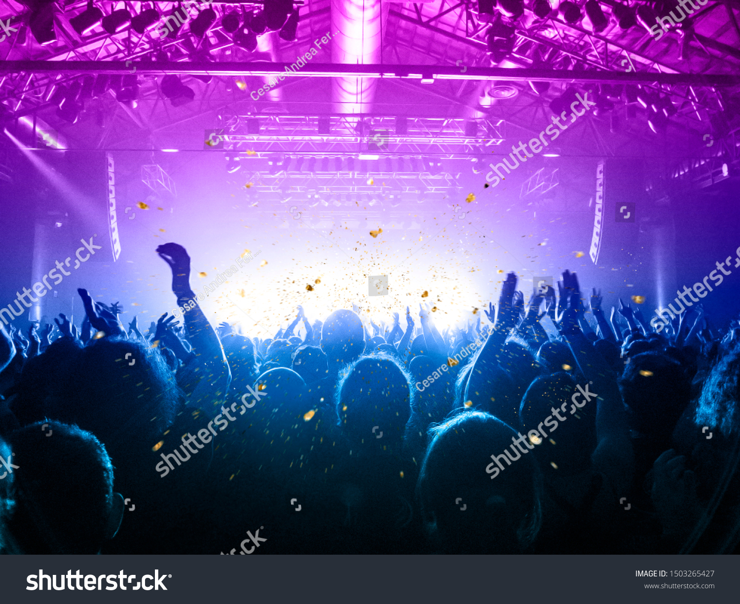 Musical event with people silhouettes clapping a live stage #1503265427