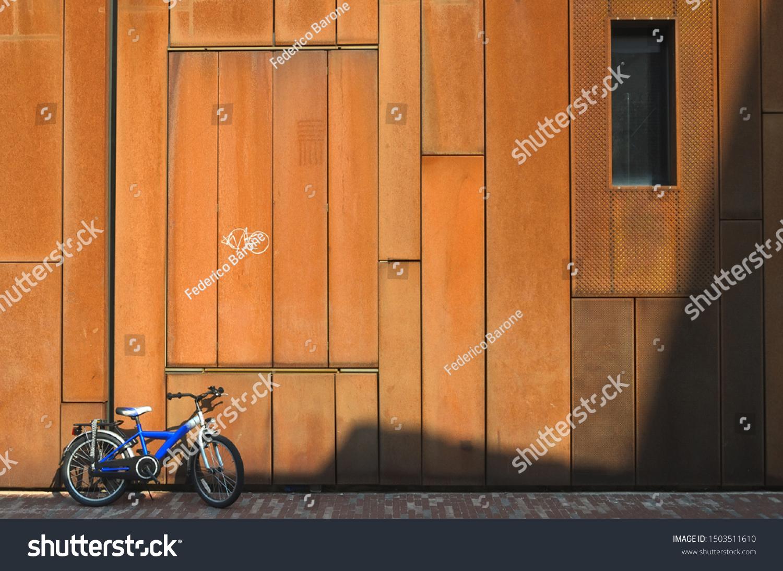 stock-photo-sunny-rusty-facade-of-an-urb