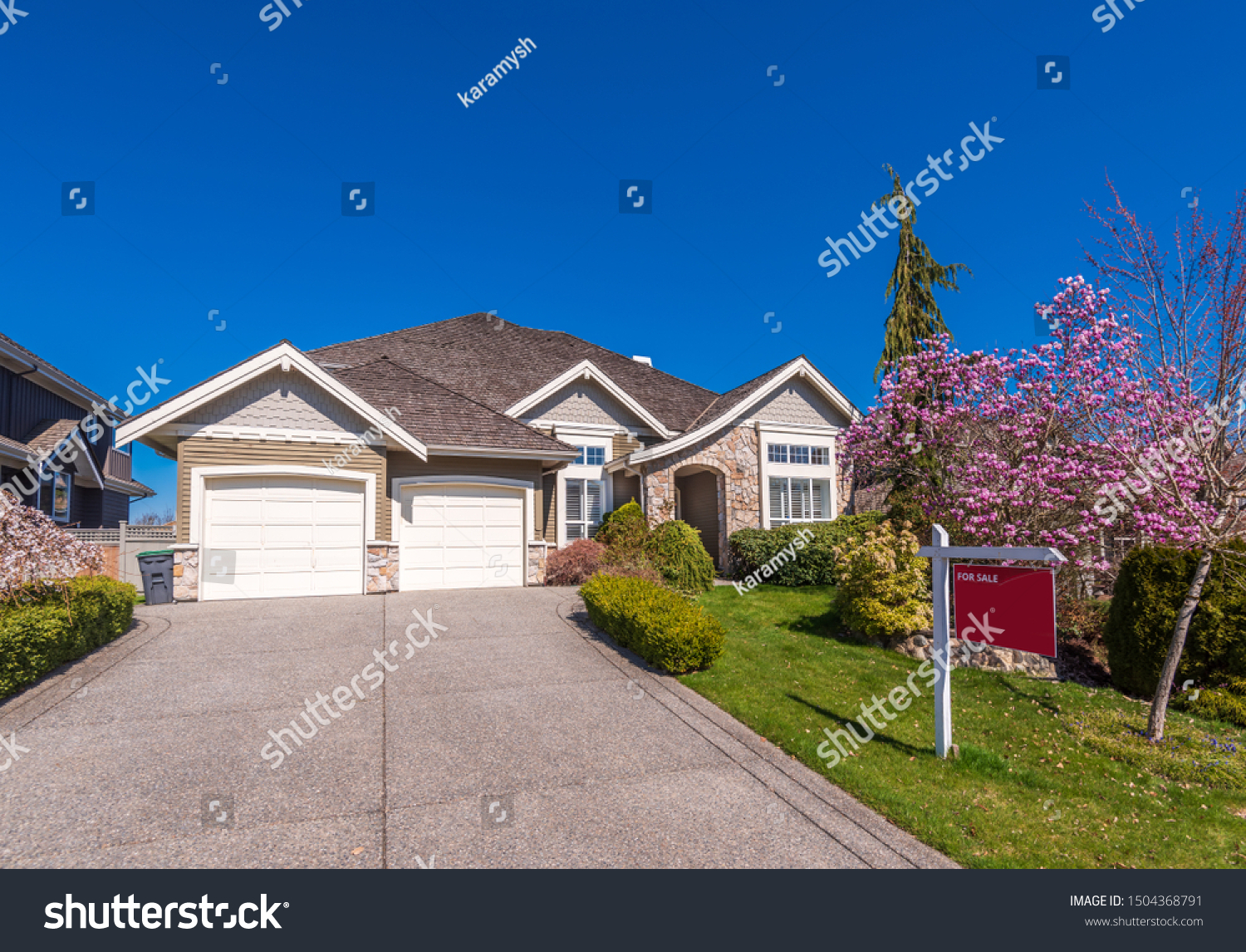 House for sale in Vancouver, Canada. Real estate sign in front of a house. #1504368791