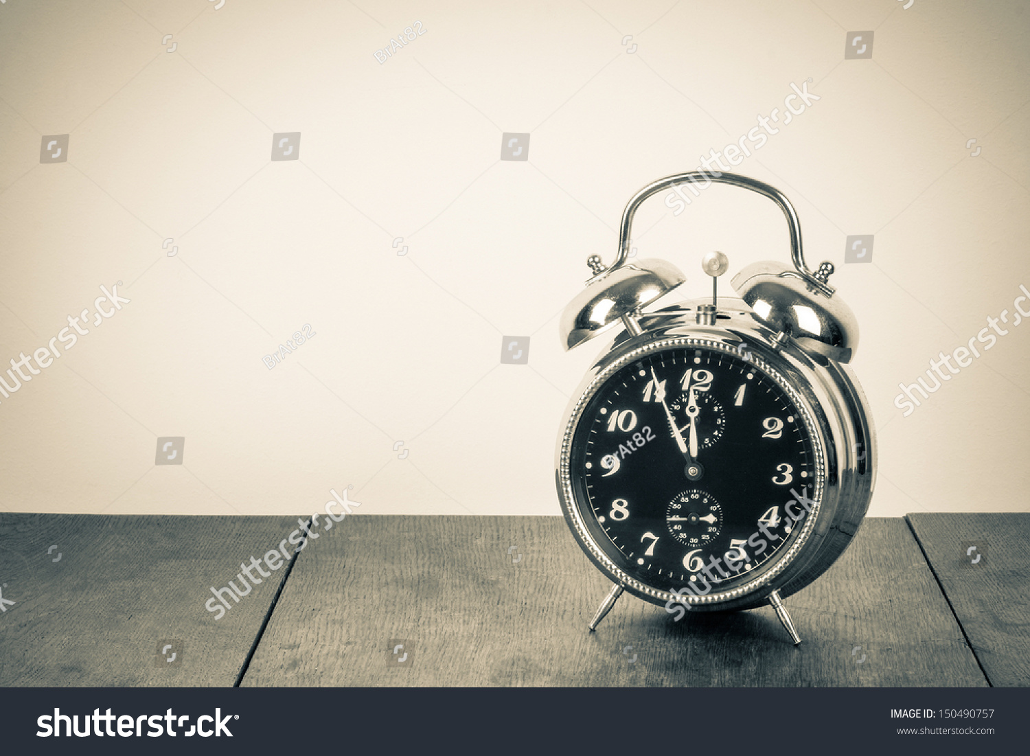 Vintage background with retro alarm clock on table #150490757
