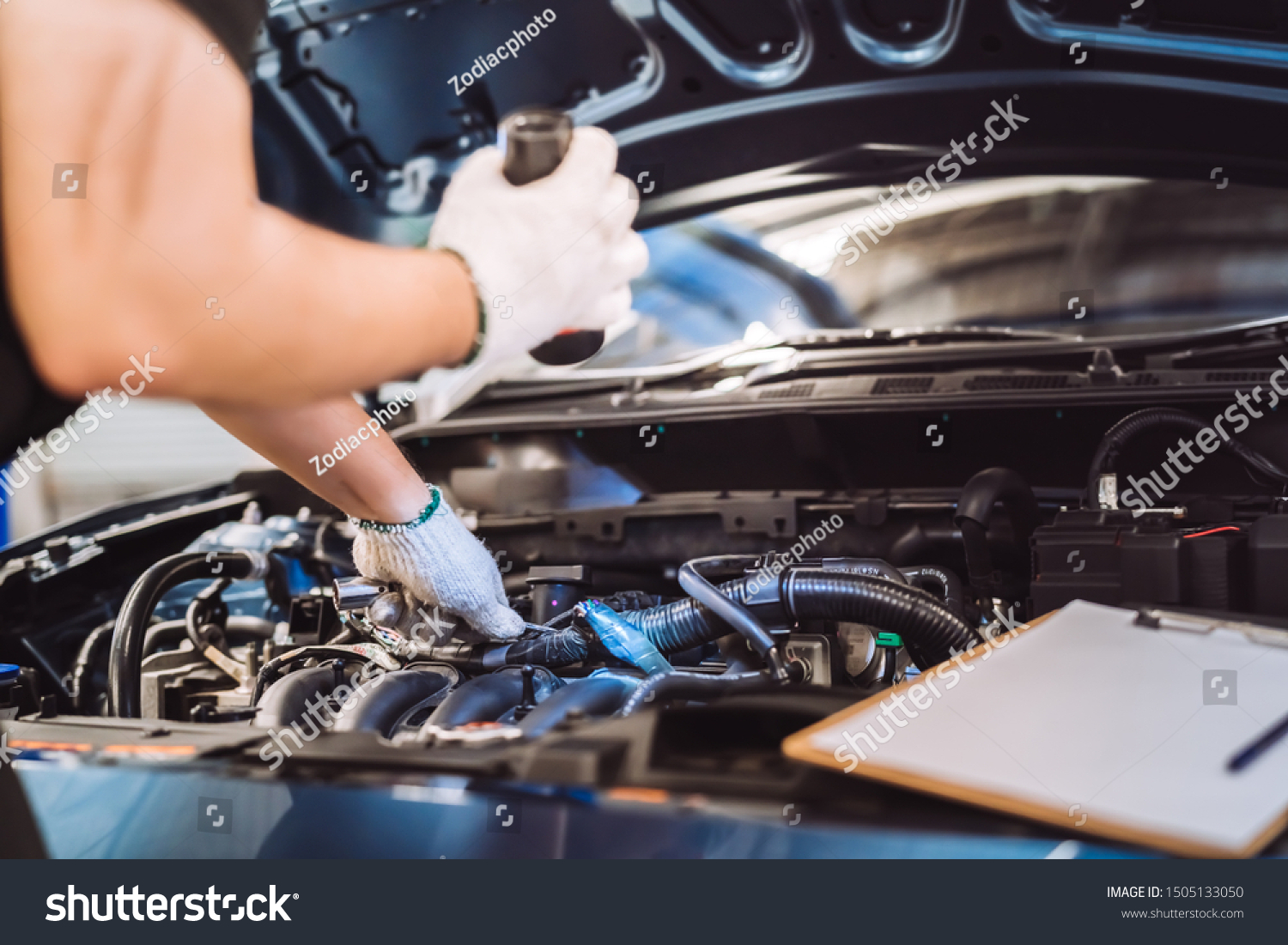 Mechanic man examining and maintenance to customer the engine a vehicle car hood, Safety inspection test engine before customer drive on a long journey, transportation repair service center #1505133050