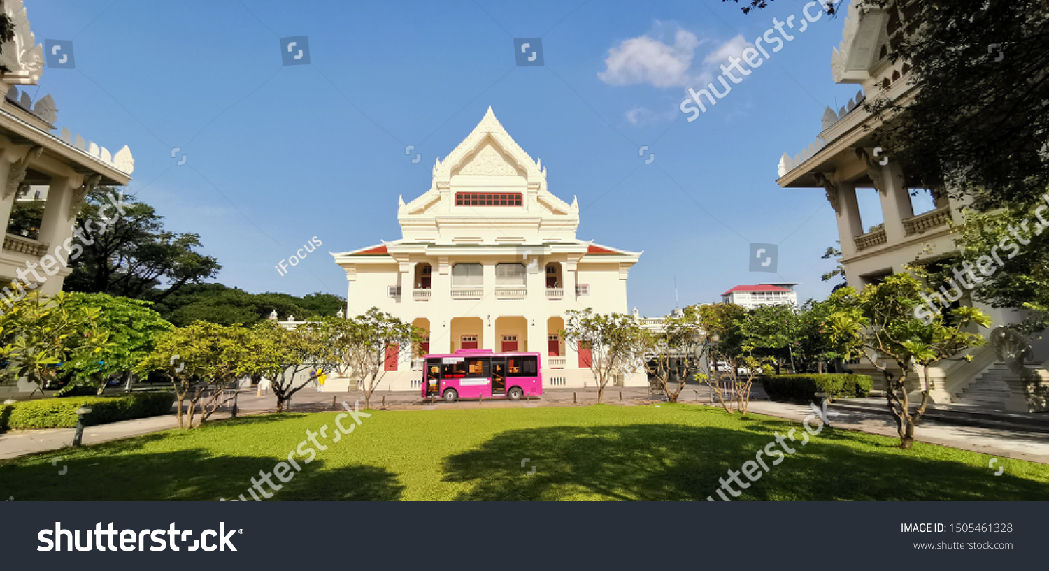 BANGKOK, THAILAND - SEPTEMBER 16, 2019: A CU bus also called a Pop Bus passes in front of the Auditorium building at Chulalongkorn University on Spetember 16, 2019 in Bangkok, Thailand.