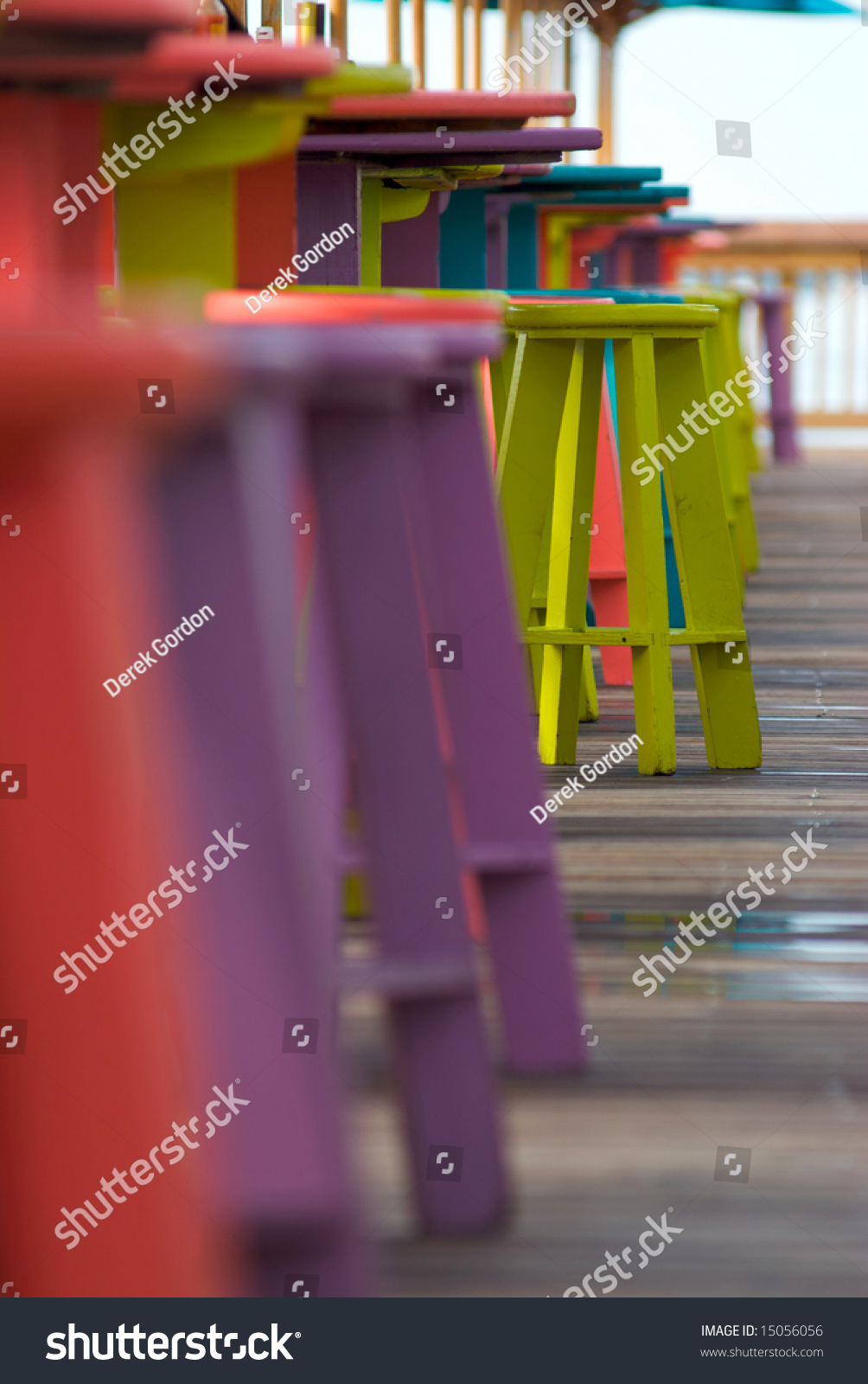 Colorful bar stools in a tropical outdoor bar and restaurant with a selective shallow focus
