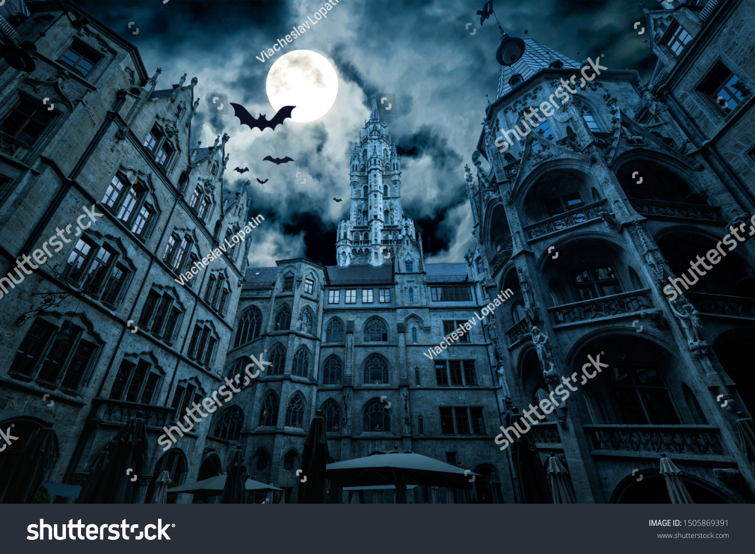 Marienplatz at night, Munich, Germany. Creepy mystery view of dark Gothic Town Hall with bats. Old spooky castle or palace in full moon. Scary gloomy scene with horror and terror for Halloween theme. #1505869391