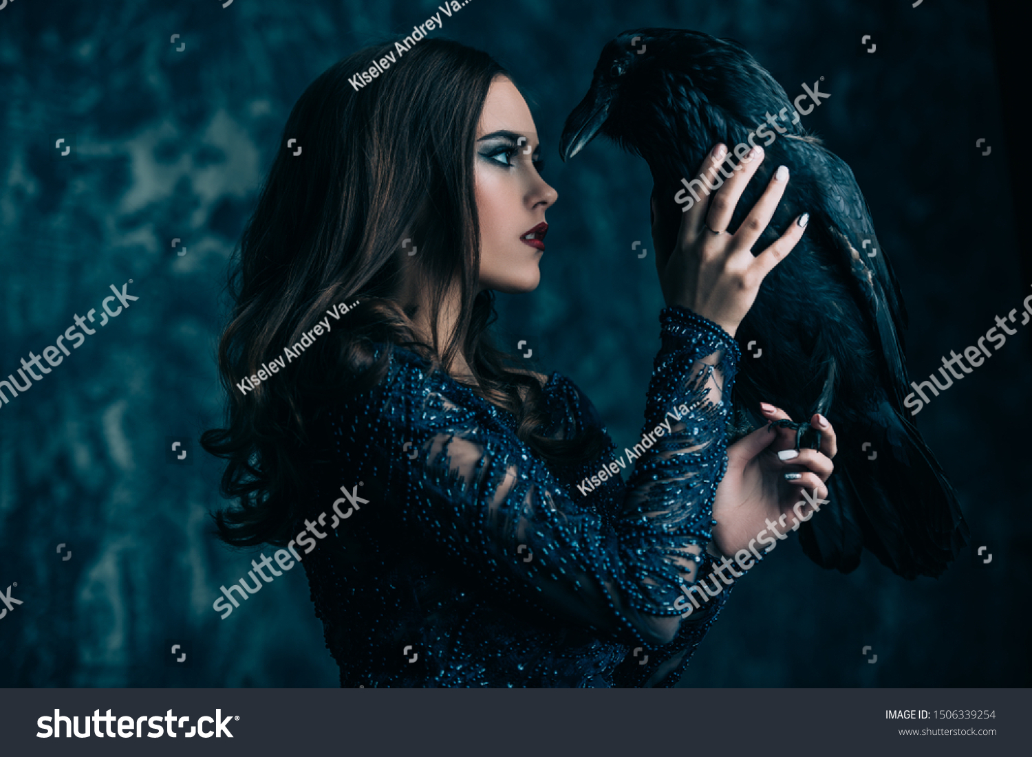 A witch in hat and dress with a raven. Halloween. Celebration. #1506339254