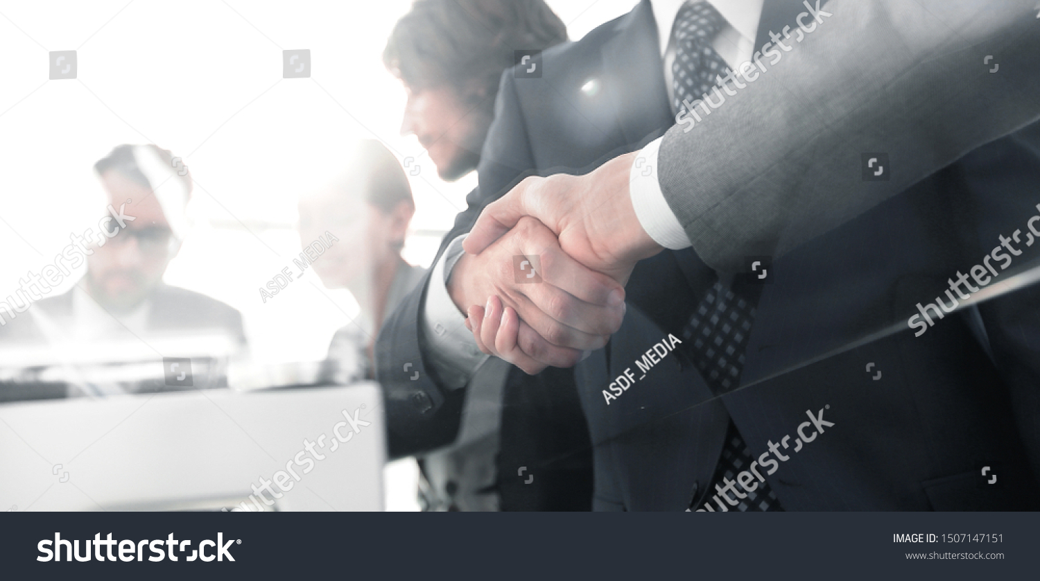handshake of business partners in conference room #1507147151