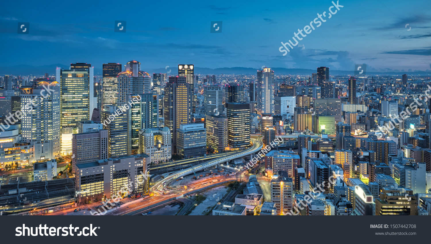 Aerial night view of Osaka city - Asia business city concept image, panoramic modern metropolis bird's eye view at evening, shot in Umeda Sky Building observatory, Osaka, Japan. #1507442708