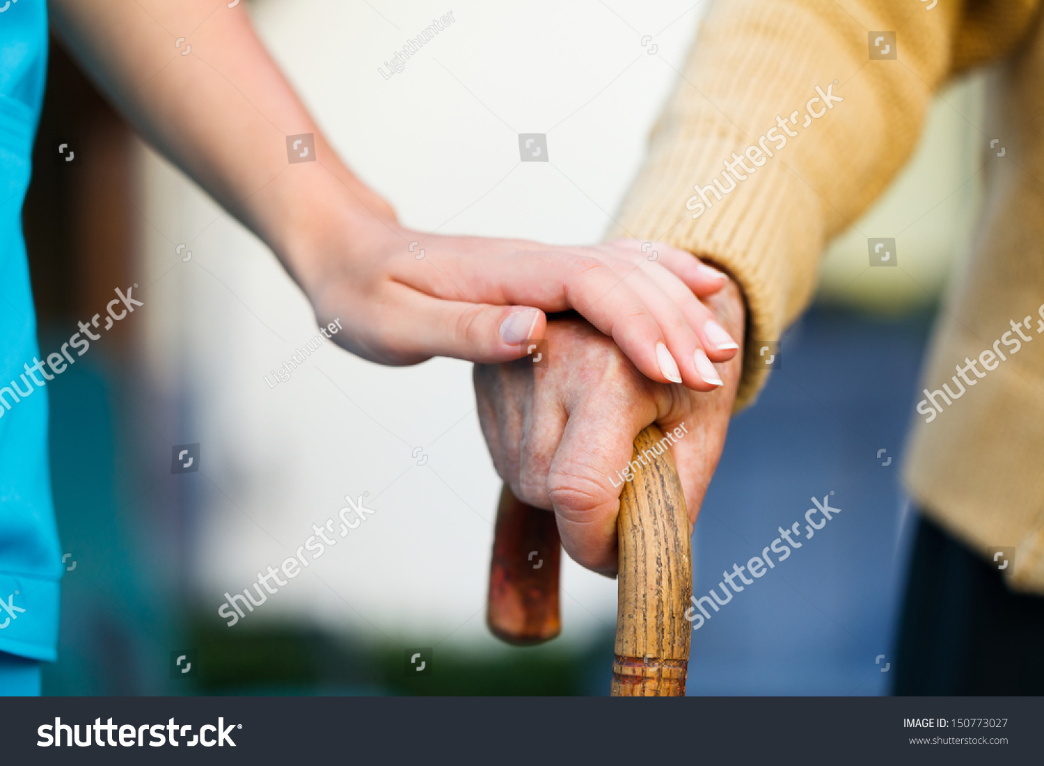 Hand Holding Stick ~ Doctor holding a senior patients s hand on walking