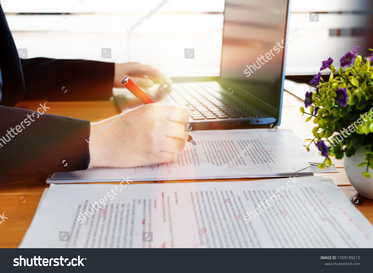 hand working on editing blur text on desk with laptop in office #1509189215