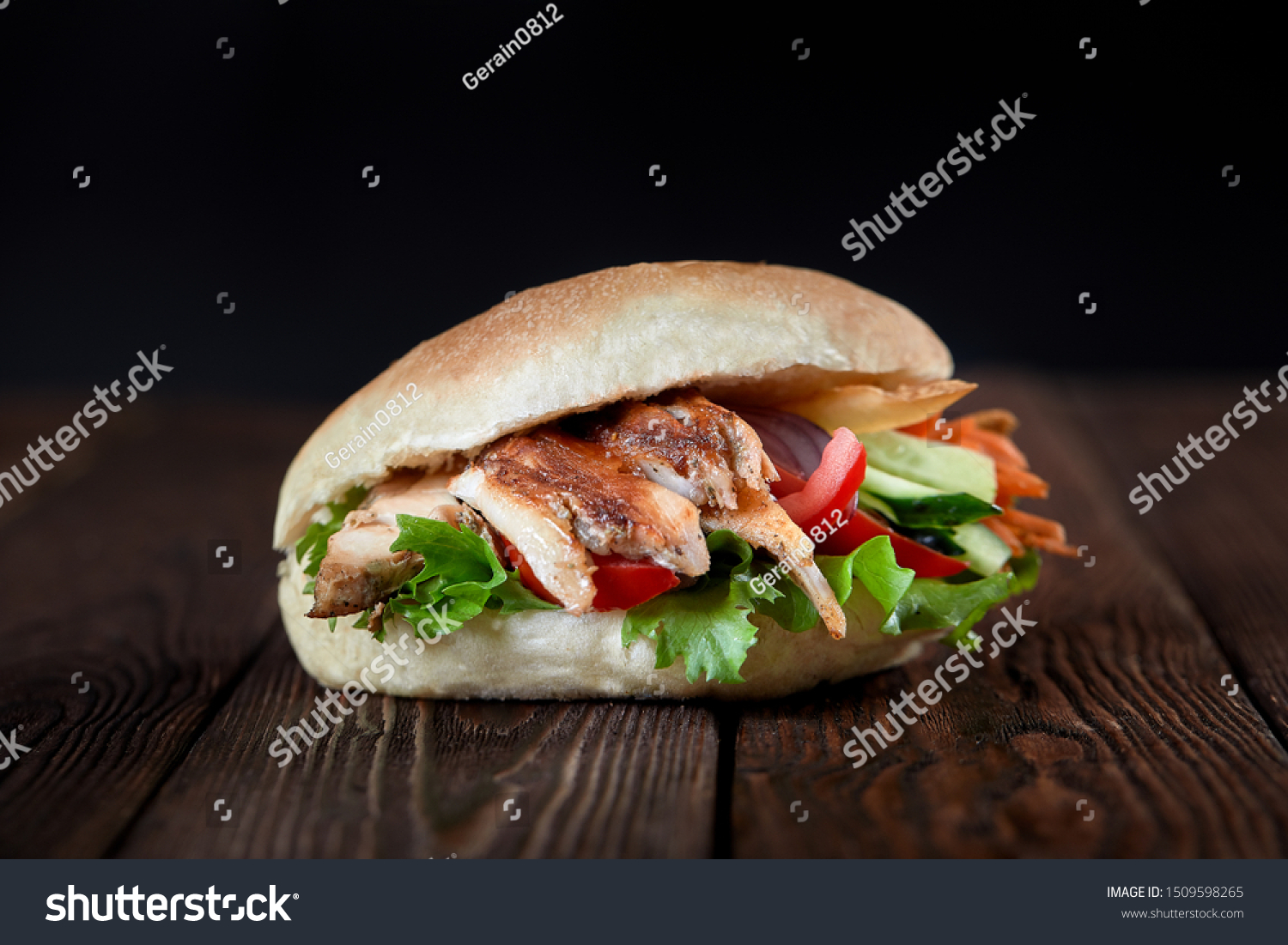 close up of kebab sandwich on wooden background #1509598265