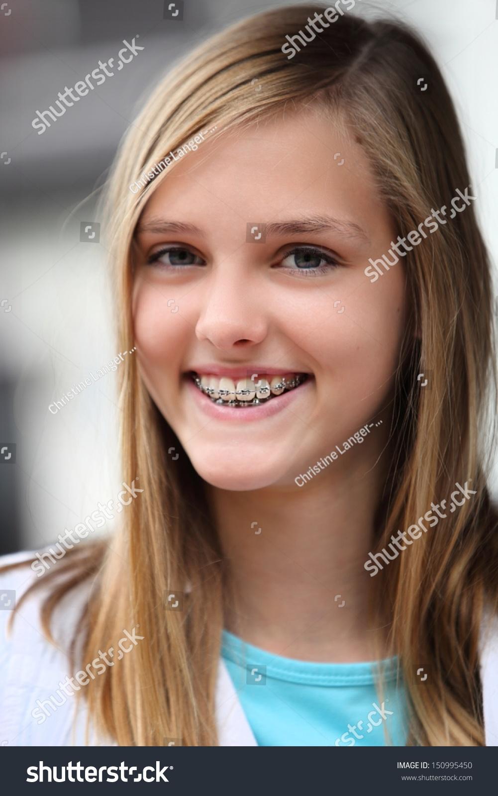 Smiling Teenage Girl Wearing Dental Braces Stock Photo