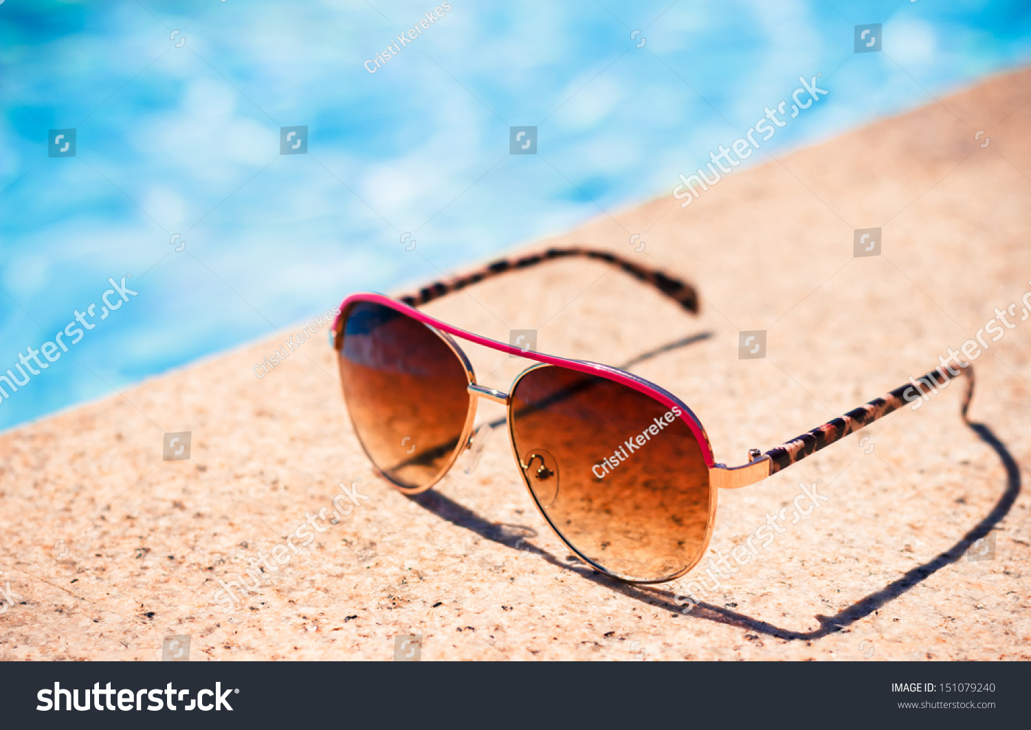 brown funky sun glasses near swimming stock photo. Black Bedroom Furniture Sets. Home Design Ideas