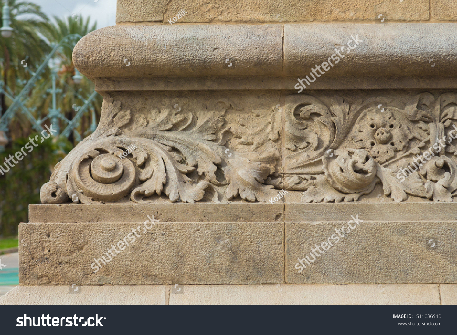 Elements of architectural decoration of buildings, stucco moldings, stucco wall texture, patterns and statues. On the streets in Catalonia, public places. #1511086910