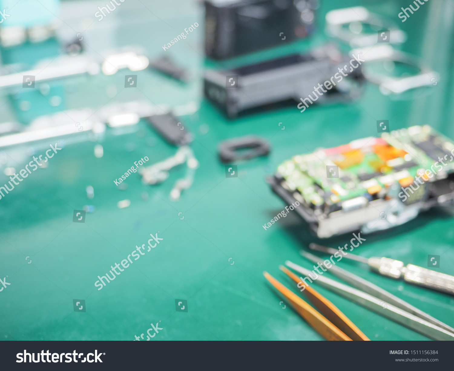 Blur image of workplace in laboratory with needed equipment and electronics device, Abstract blurred of Repair of electronic devices, Repairing and service concept. #1511156384