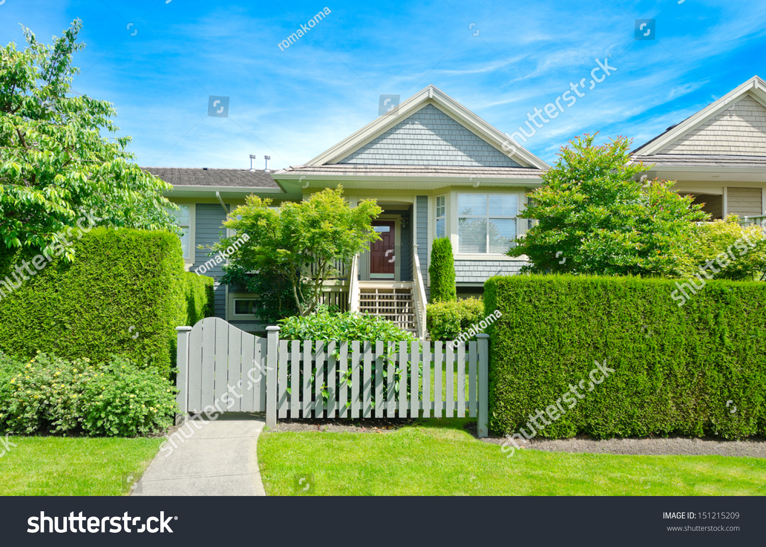 Nice Looking House Behind Wooden Nicely Stock Photo
