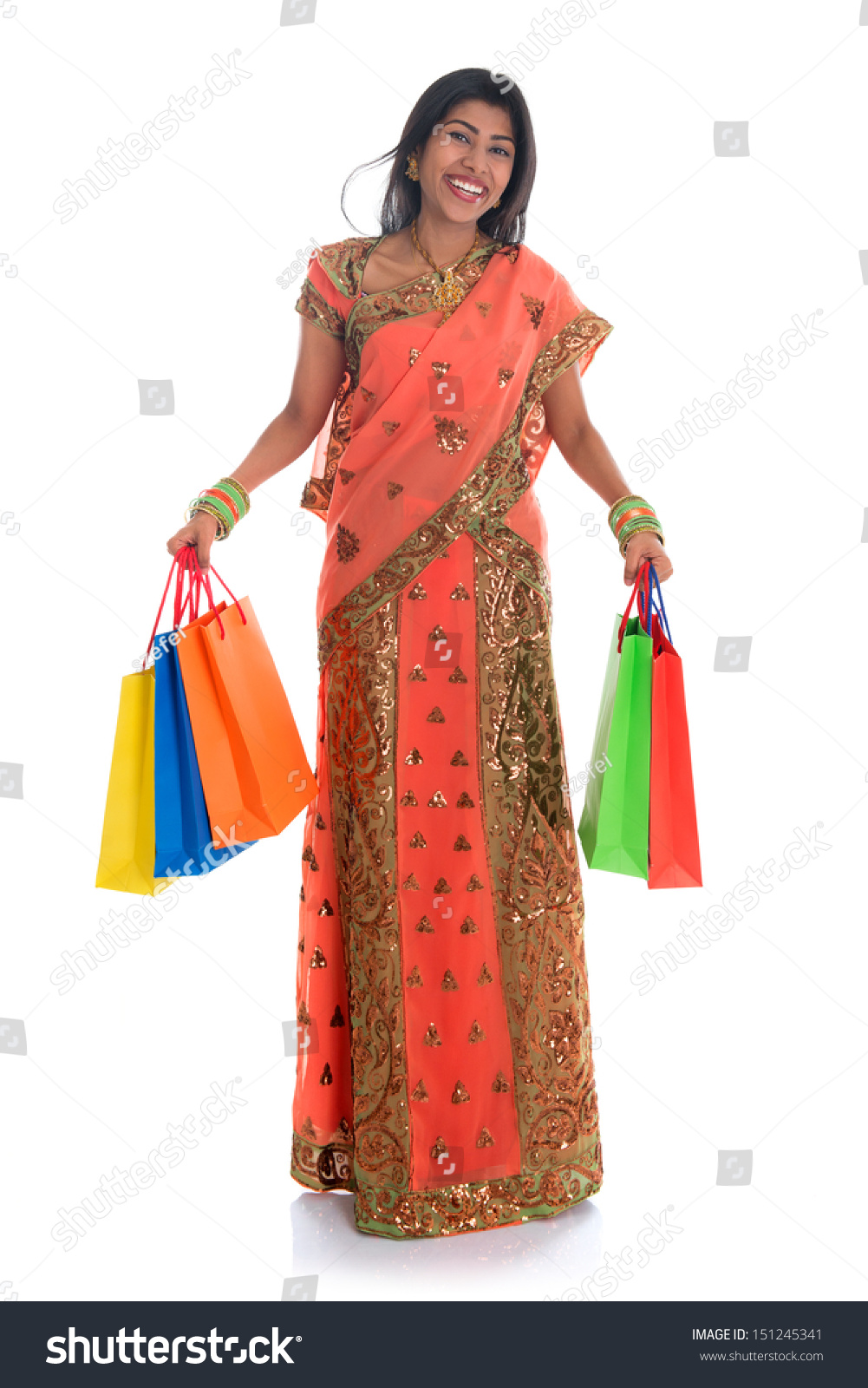 Woman posing with shopping bags isolated on white background full - Portrait Of Full Length Beautiful Traditional Indian Woman In Sari Dress Holding Shopping Bags Isolated