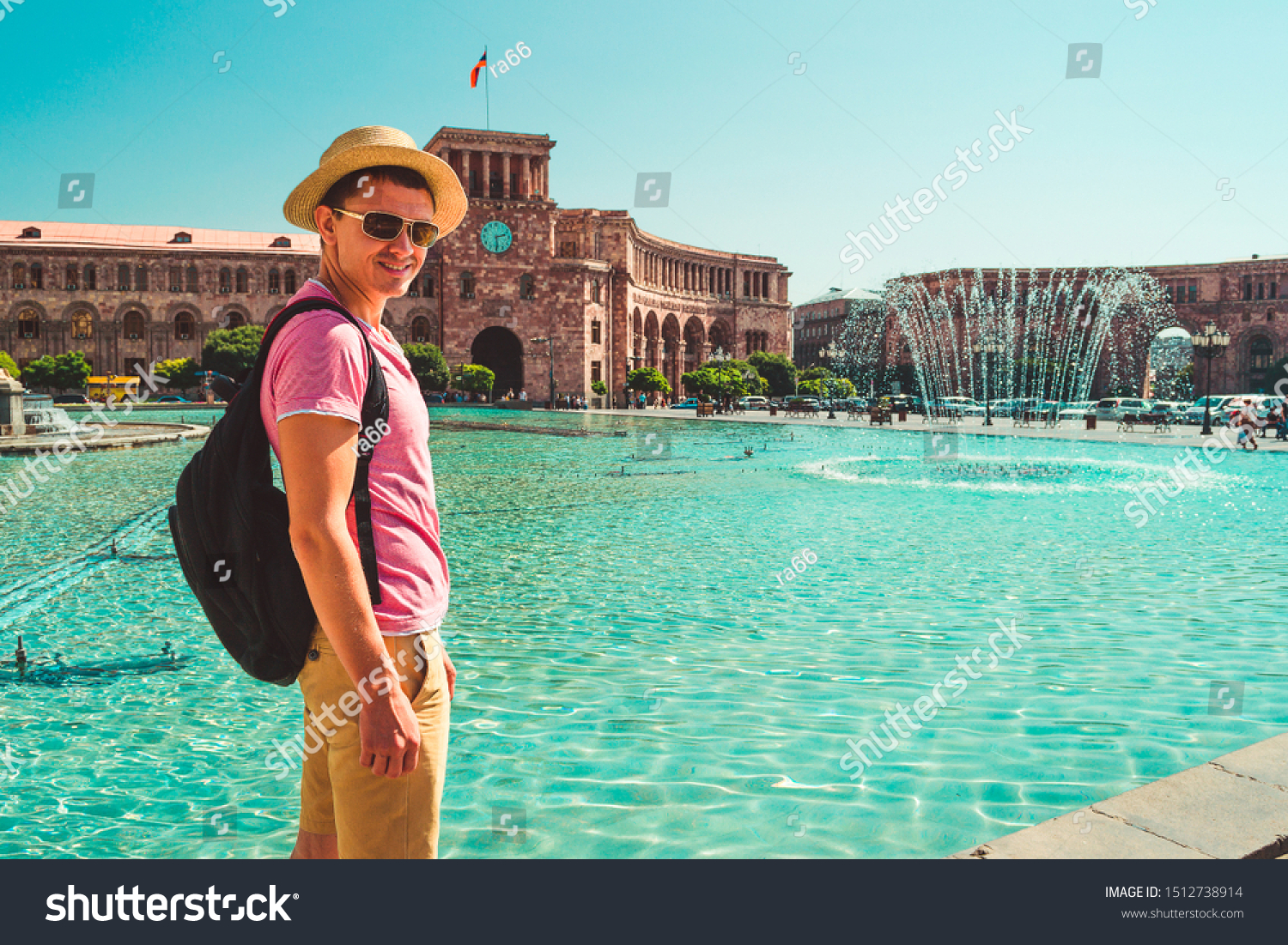 Male tourist in hat with backpack on central square of Yerevan. Caucasian adult man alone explore Armenia. Touristic architecture landmark. Sightseeing city tour. Travel and armenian tourism concept. #1512738914