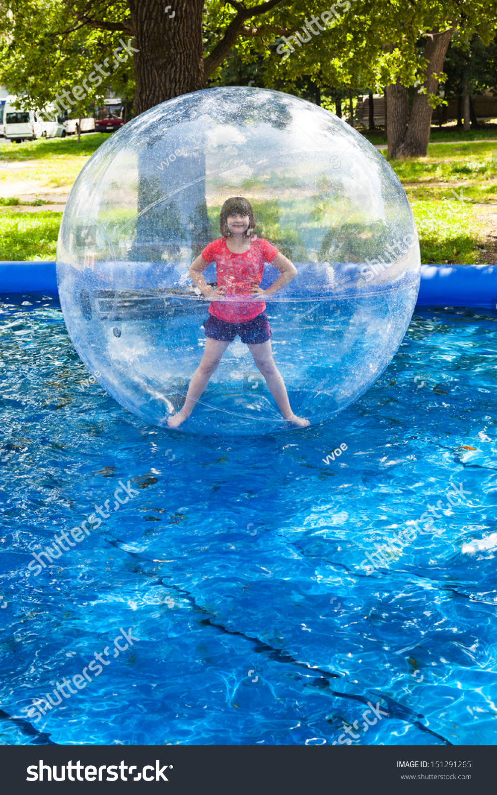 girl in water ball in open swimming pool stock photo 151291265 shutterstock