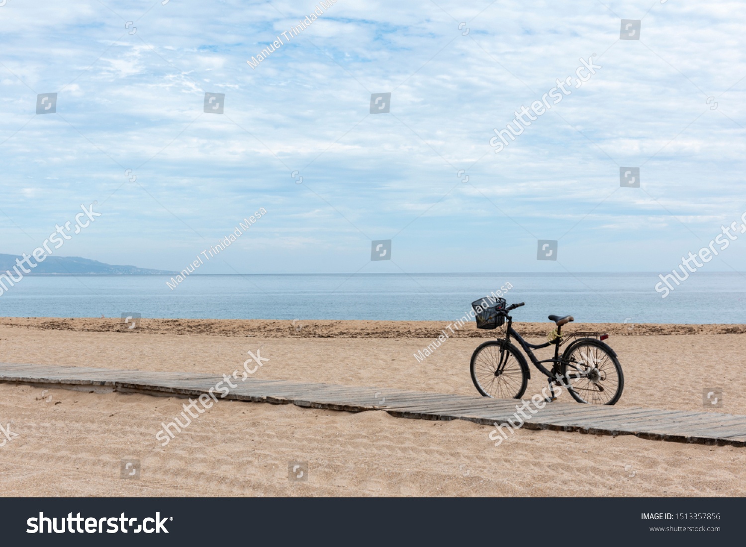 A bicycle on the sand of the beach