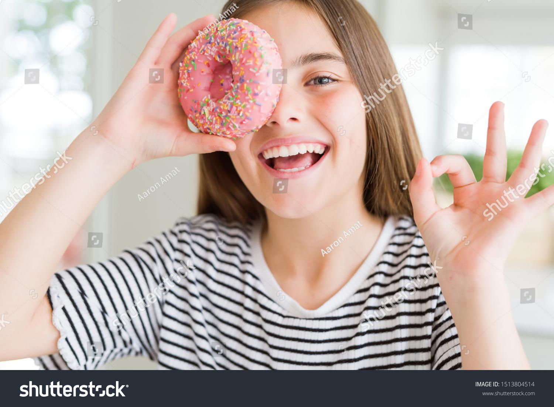 Beautiful Young Girl Kid Eating Sweet Stock Photo Edit Now