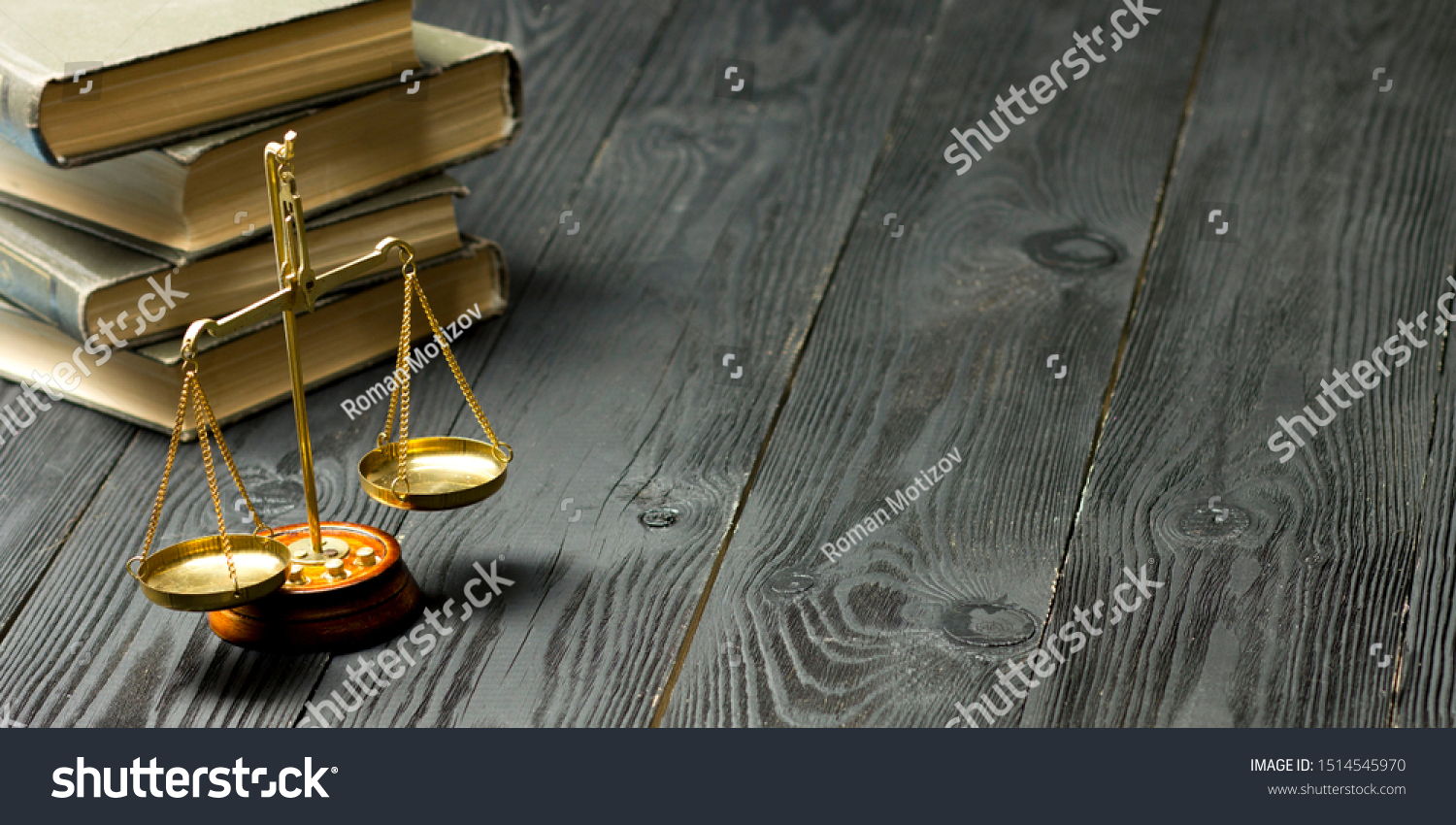Law concept - Open law book with a wooden judges gavel on table in a courtroom or law enforcement office isolated on white background. Copy space for text. #1514545970