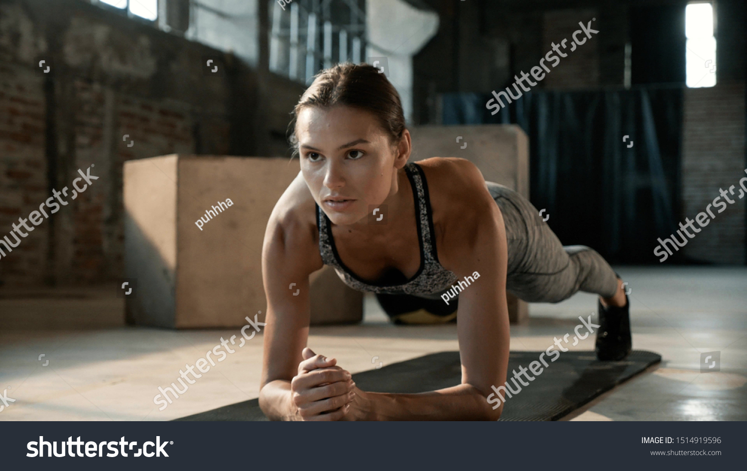 Fitness woman doing plank exercise workout in gym. Sport girl model in sportswear exercising on yoga mat, planking indoors #1514919596