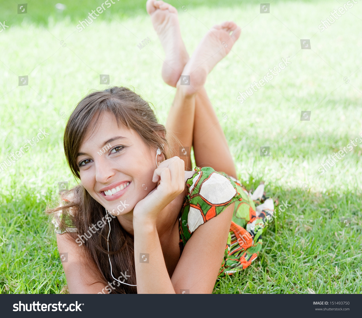 Mp3 Young Down: Attractive Young Woman Laying Down On Stock Photo