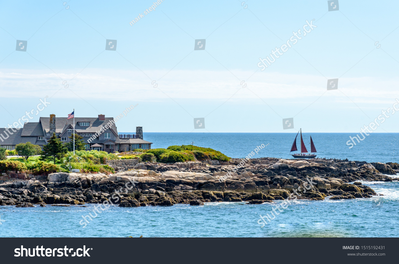 stock-photo-a-three-sail-sailboat-sailin