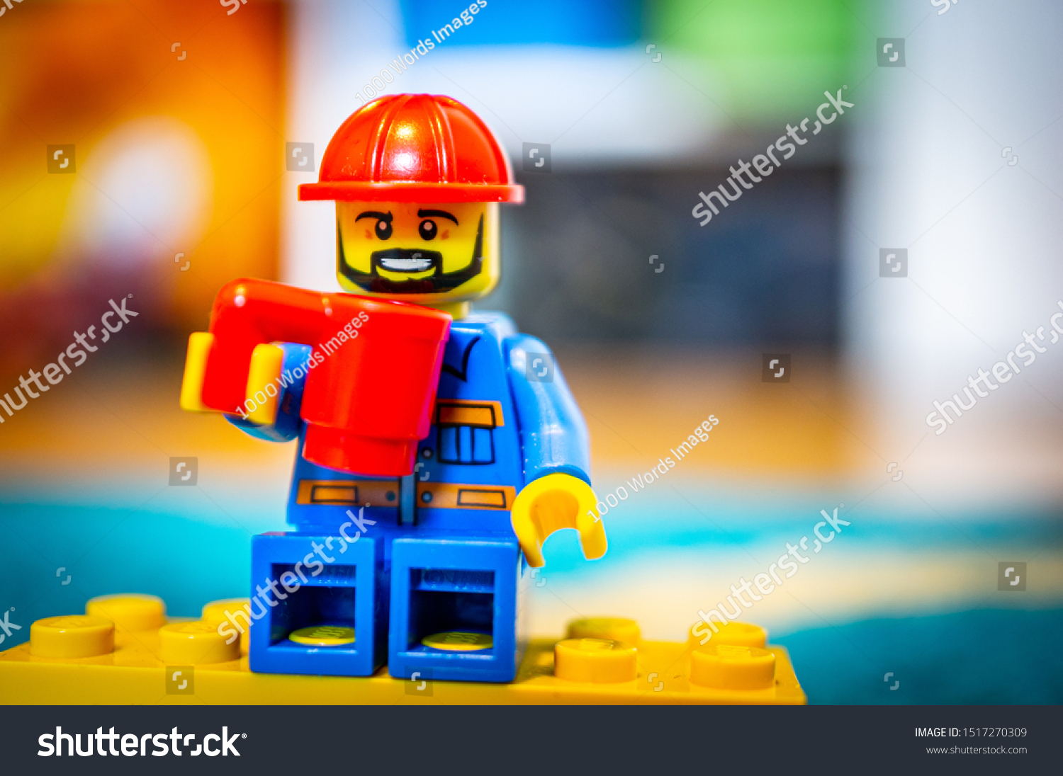 Lego Construction Worker Safety Helmet Holding Stock Photo Edit Now 1517270309