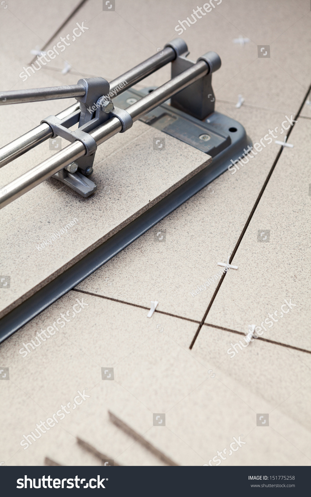 Cutting tiles tilecutter on floor when stock photo 151775258 cutting tiles with tile cutter on floor when laying floor dailygadgetfo Gallery