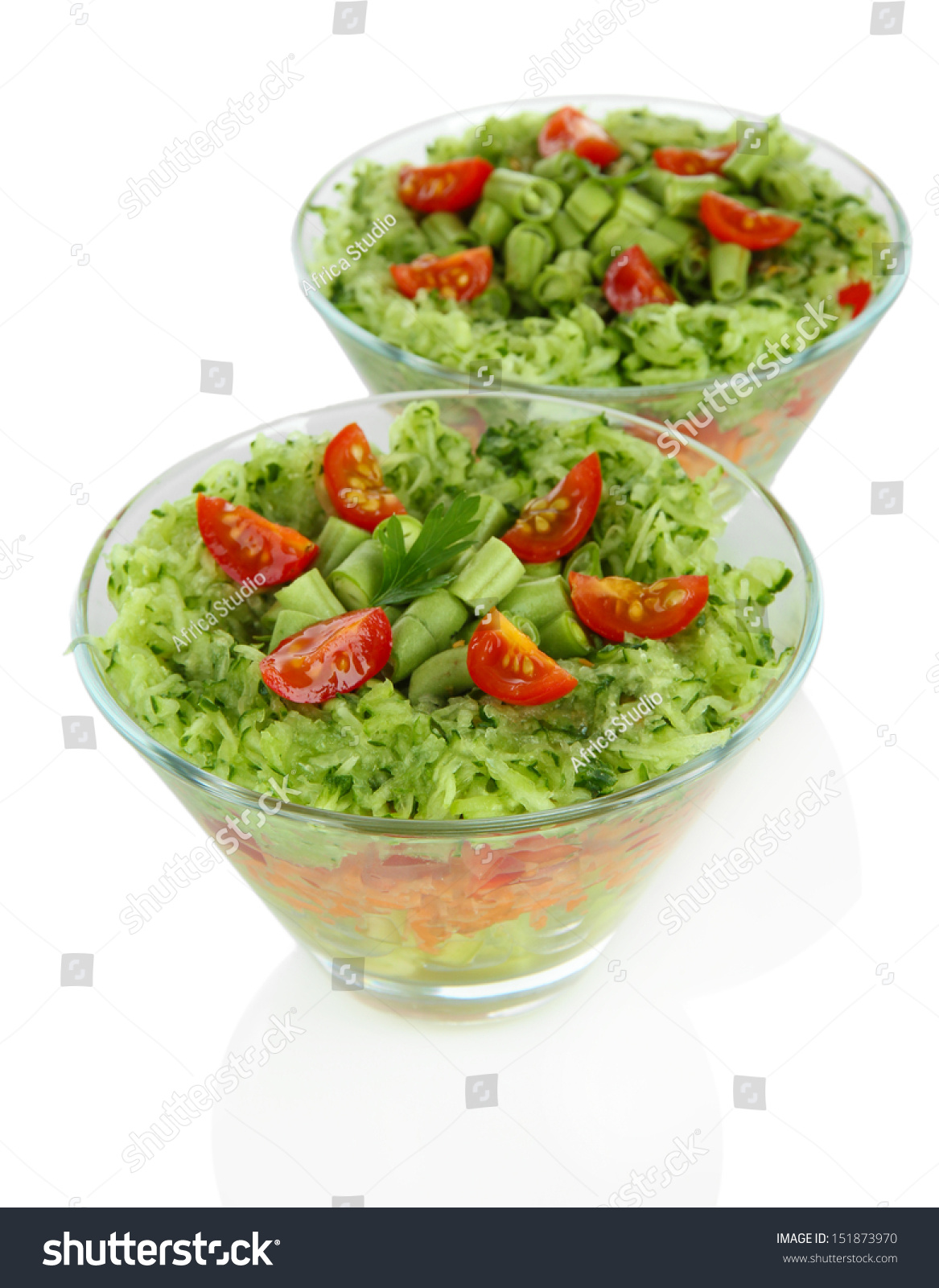 Tasty salad with fresh vegetables isolated on white