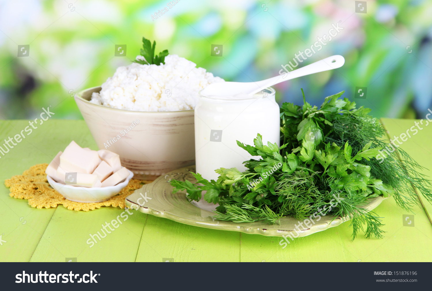 Fresh Dairy Products Greens On Wooden Stock Photo