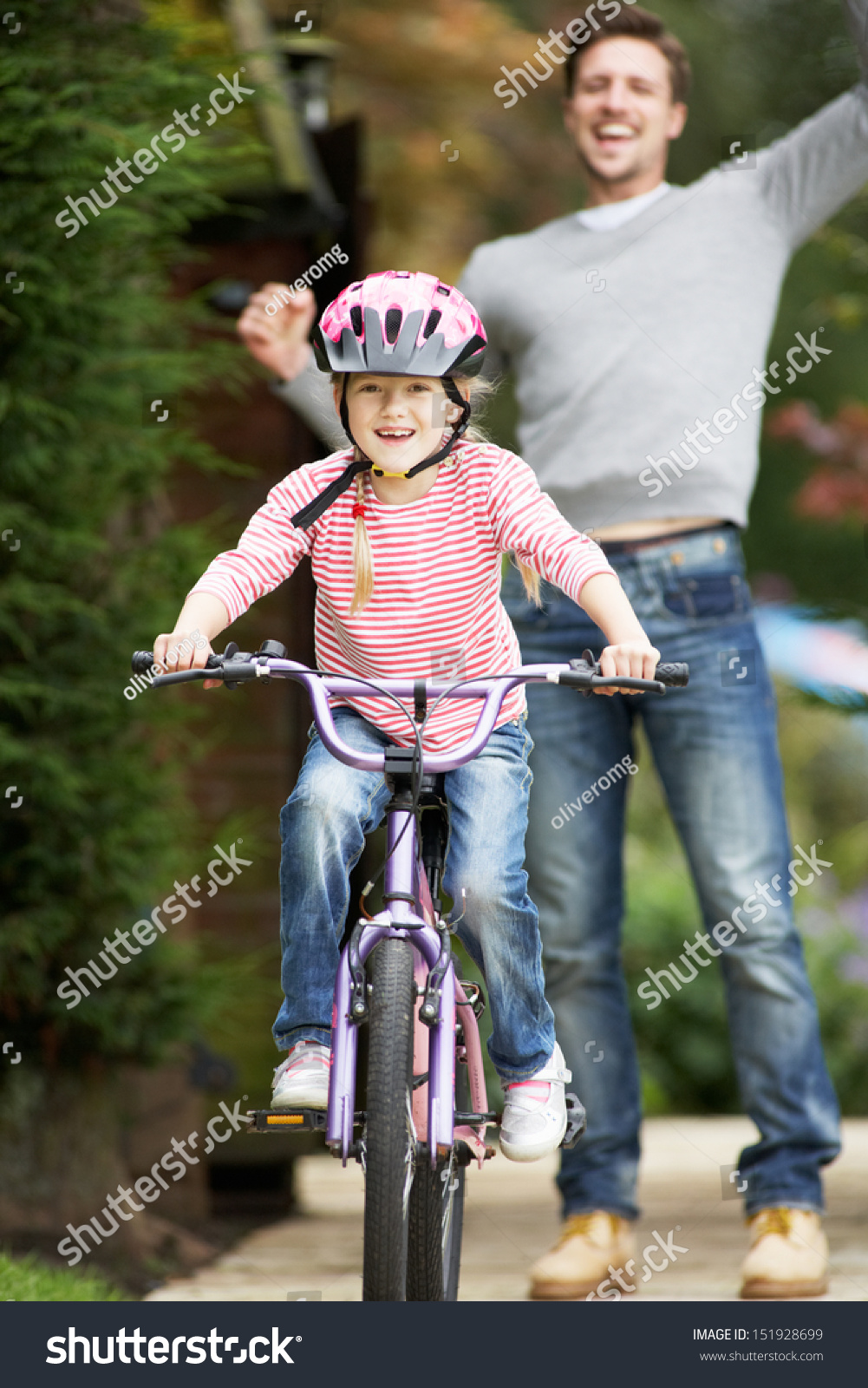 Daughter rides dad