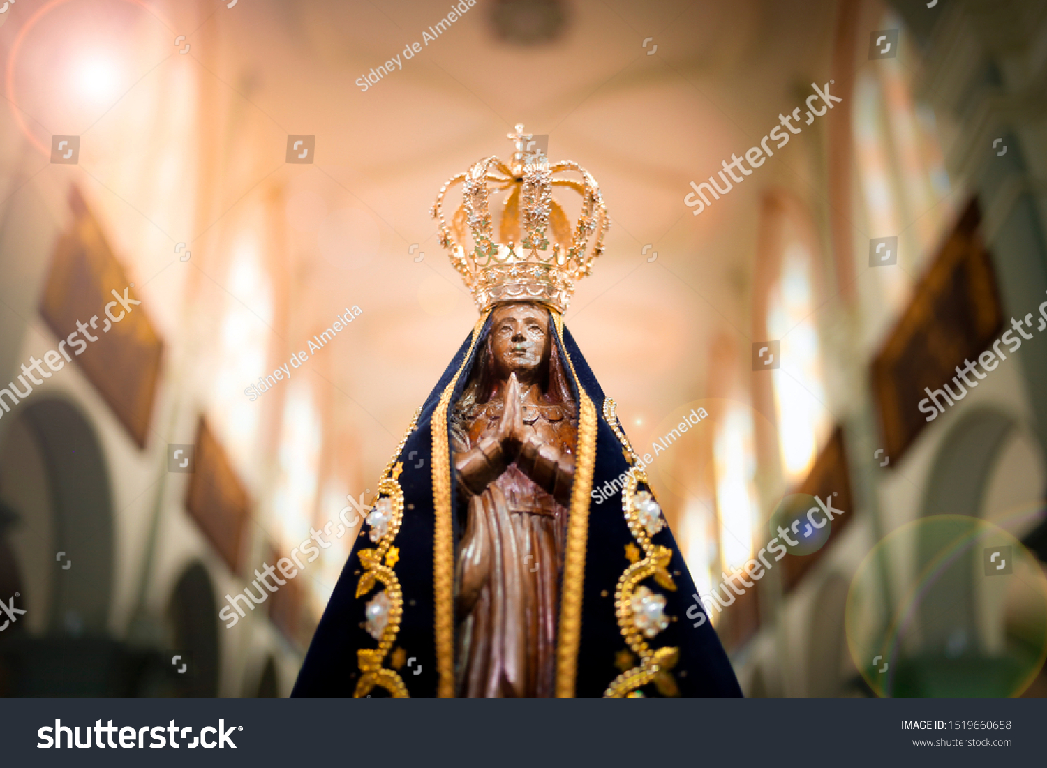 Statue of the image of Our Lady of Aparecida, mother of God in the Catholic religion, patroness of Brazil #1519660658