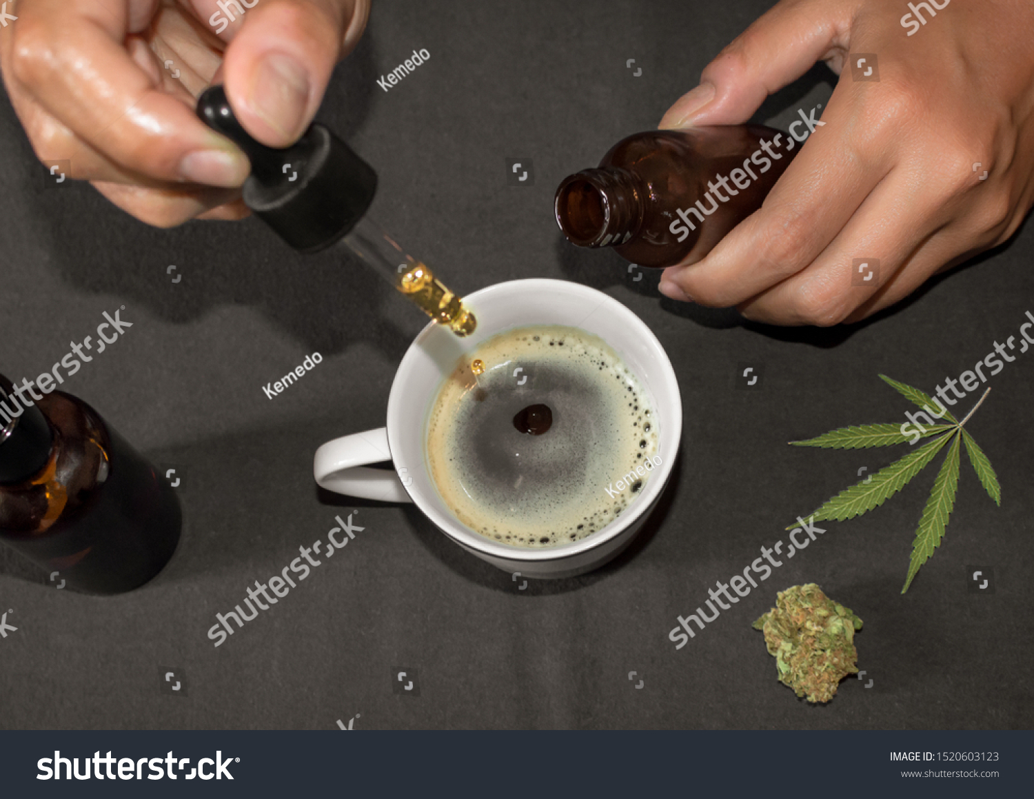 Pouring CBD tincture in a coffee cup, natural remedy of marihuana. Person using cannabis oil with a dropper in a table with marihuana leaf. #1520603123